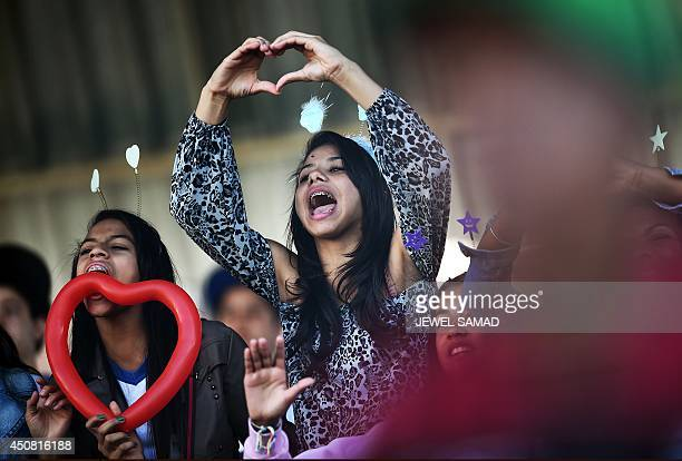 Fans cheer for Portugal's forward Cristiano Ronaldo as he takes part in a training session in Campinas Sao Paulo on June 18 during the 2014 FIFA...