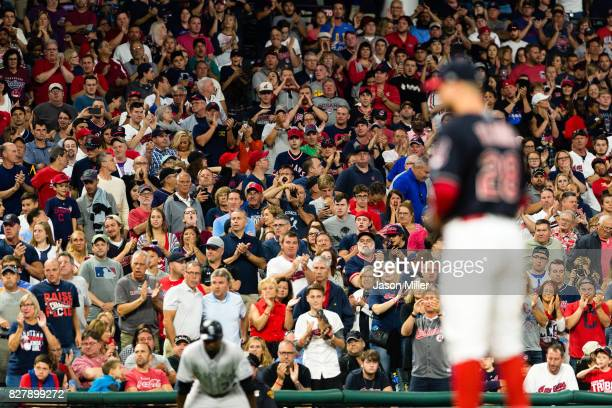 Fans cheer for starting pitcher Corey Kluber of the Cleveland Indians during the ninth inning against the Colorado Rockies at Progressive Field on...