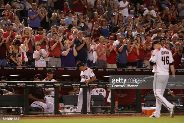 Fans cheer for starting pitcher Patrick Corbin of the Arizona Diamondbacks as he leaves the MLB game against the Colorado Rockies during the seventh...