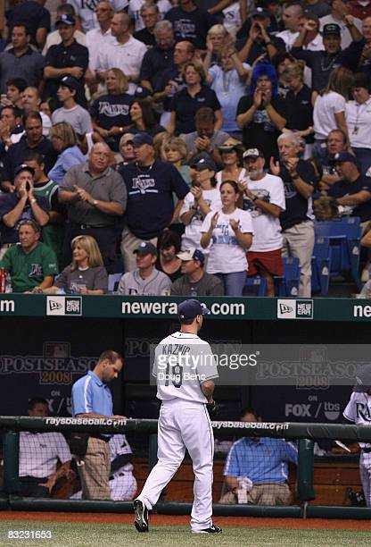 Fans cheer for starting pitcher Scott Kazmir of the Tampa Bay Rays as he walks back to the dugout after the fourth inning of game two of the American...