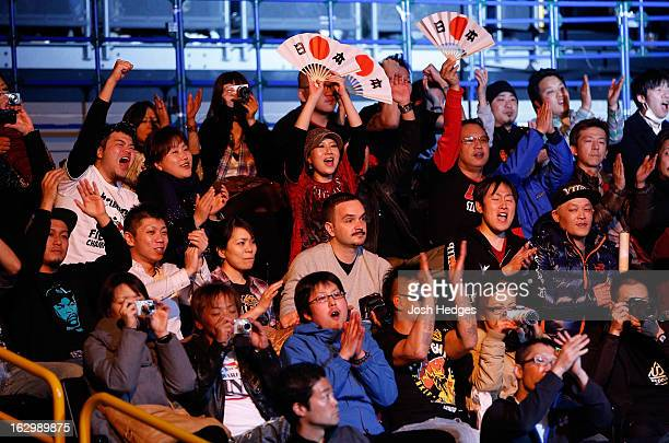Fans cheer for Takanori Gomi before his lightweight fight against Diego Sanchez during the UFC on FUEL TV event at Saitama Super Arena on March 3...