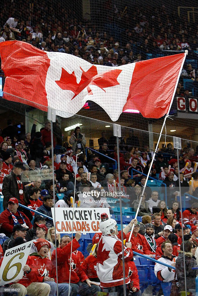 Fans cheer for Team Canada during the 2010 IIHF World Junior Championship Tournament game against Team USA on December 31, 2009 at the Credit Union Centre in Saskatoon, Saskatchewan, Canada. Team Canada defeated Team USA 5-4 in a shootout.