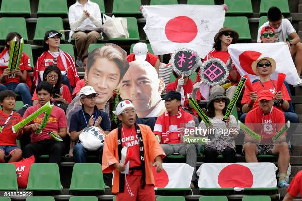 Fans cheer for Team Japan during the singles match between Yuichi Sugita of Japan and Thiago Monteiro of Brazil during day four of the Davis Cup...