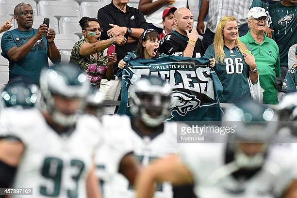Fans cheer for the Philadelphia Eagles prior to a game against the Arizona Cardinals at University of Phoenix Stadium on October 26 2014 in Glendale...