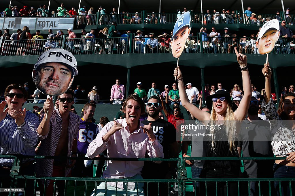 Fans cheer for their favorite golfer on the 16th hole during the third round of the Waste Management Phoenix Open at TPC Scottsdale on February 6, 2016 in Scottsdale, Arizona.