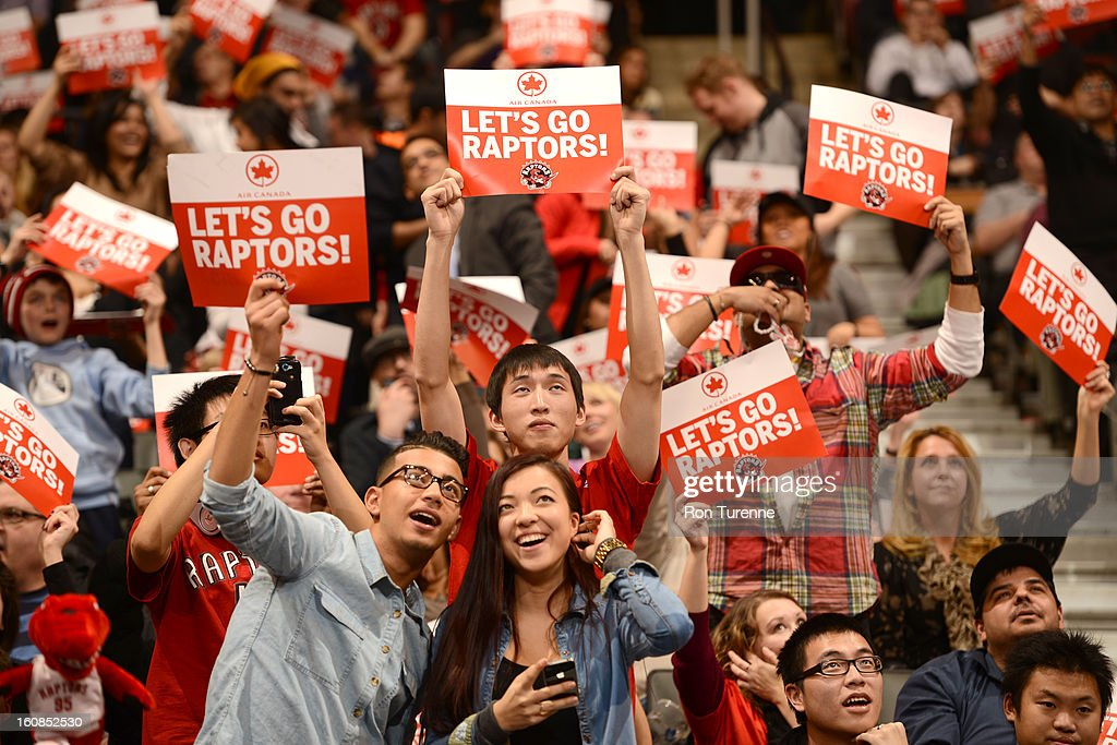 Fans cheer for their home team during the game between the the Toronto Raptors and the Boston Celtics on February 6, 2013 at the Air Canada Centre in Toronto, Ontario, Canada.