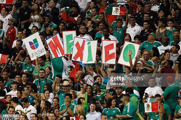 Fans cheer for their team as Mexico plays Nigeria at Reliant Stadium on May 31 2013 in Houston Texas