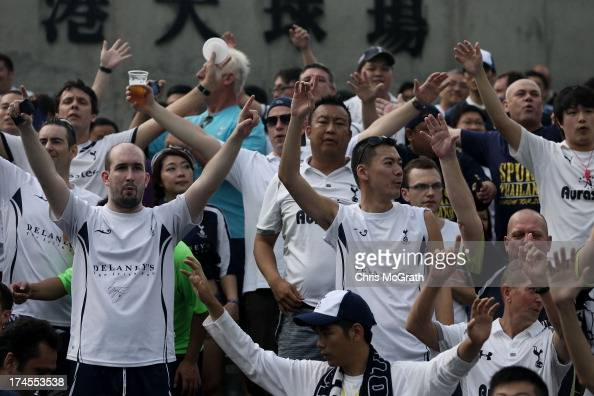 Fans cheer for their team during the Third Place PlayOff match between Tottenham and South China at Hong Kong Stadium on July 27 2013 in So Kon Po...
