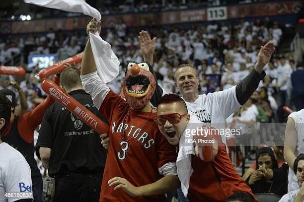 Fans cheer for their team the Toronto Raptors where they took on the Brooklyn Nets during Game Two of the Eastern Conference Quarterfinals of the...