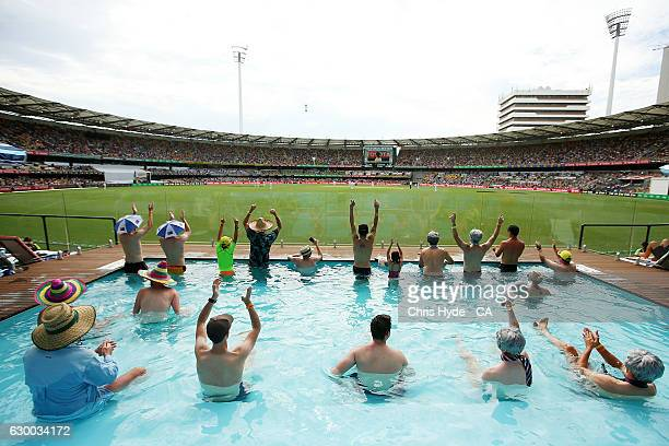 Fans cheer from the Pool Deck during day two of the First Test match between Australia and Pakistan at The Gabba on December 16 2016 in Brisbane...