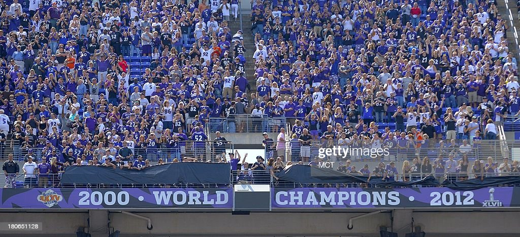 Fans cheer in at M&T Bank Stadium as the 2012 championship banner is unveiled prior to the Baltimore Ravens game with the Cleveland Browns on Sunday, September 15, 2013, in Baltimore, Maryland.