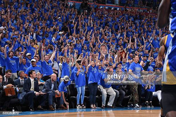 Fans cheer in Game Six of the Western Conference Finals between the Golden State Warriors and Oklahoma City Thunder during the 2016 NBA Playoffs on...