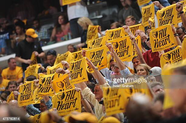 Fans cheer in Game Six of the Western Conference Semifinals between the Memphis Grizzlies and the Golden State Warriors during the 2015 NBA Playoffs...