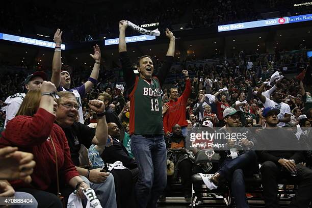 Fans cheer in Game Three of the Eastern Conference Quarterfinals between the Milwaukee Bucks and the Chicago Bulls during the 2015 NBA Playoffs on...