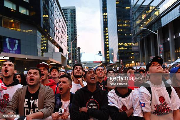 Fans cheer in 'Jurassic Park' during game 3 of the NBA Eastern Conference Finals between Cleveland Cavaliers and the Toronto Raptors at Air Canada...