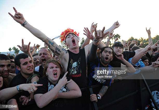 Fans cheer in the audience during the Slayer performance at The Big 4 held at the Empire Polo Club on April 23 2011 in Indio California