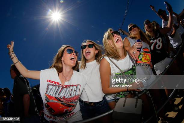 Fans cheer in the grandstands prior to the Monster Energy NASCAR Cup Series GEICO 500 at Talladega Superspeedway on May 7 2017 in Talladega Alabama