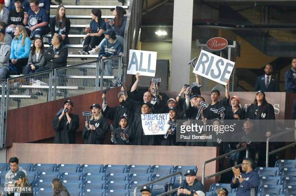 Fans cheer in the Judge's Chambers in right field at Yankee Stadium when Aaron Judge of the New York Yankees comes up to bat in an MLB baseball game...