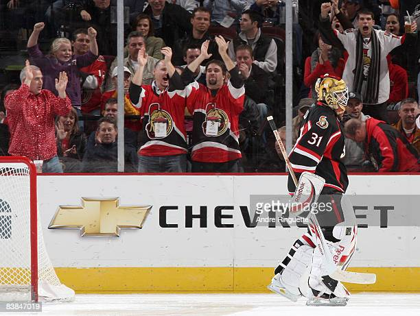 Fans cheer on Alex Auld of the Ottawa Senators after a save in a shootout against the Toronto Maple Leafs at Scotiabank Place November 27 2008 in...
