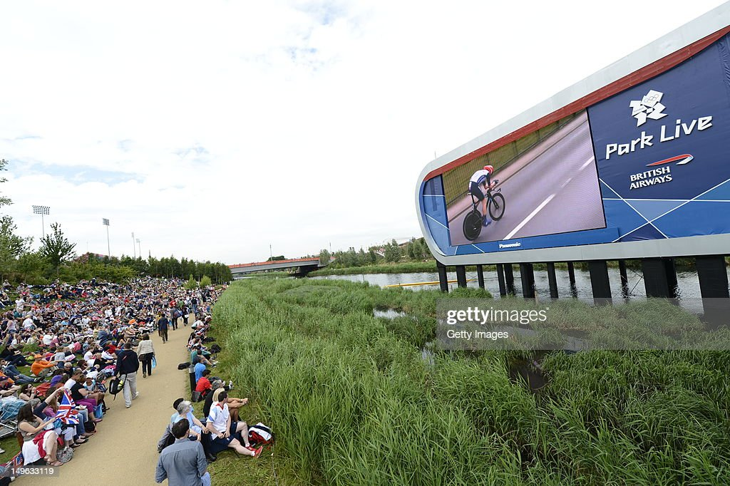 Fans cheer on Bradley Wiggins of Great Britain who rode to Gold medal victory in the Men's Individual Time Trial Road Cycling, at Park Live presented by British Airways on day 5 of the London 2012 XXX Olympic Games on August 1, 2012 in London, United Kingdon. The parkland area in the Olympic Park offers a dedicated area for fans with giant LED screens and a BA Stage where athletes are interviewed. Visitors are welcomed by BA Lawn Hosts who are on hand to look after the 10,000 daily visitors. The dedicated area for fans expects up to 10,000 daily visitors who can watch live action on the giant LED screens and see the athletes interviewed on the BA Stage.