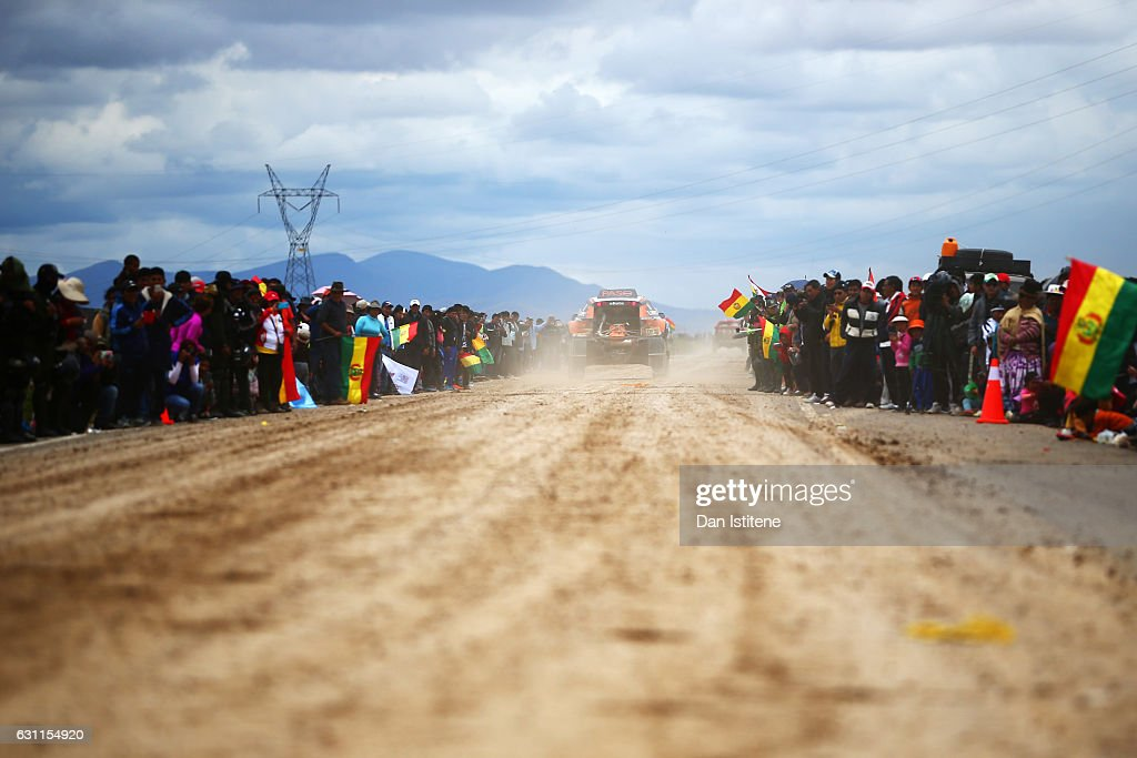 Fans cheer on Eric Bernard of France and BUGGY Sodicars and co-driver Alexandre Vigneau of France in their BUGGY BV2-1 Proto Sodicars Racing Buggy car as they depart the camp after stage six of the 2017 Dakar Rally between Oruro and La Paz was cancelled due to weather condtitons on January 7, 2017 in Oruro, Bolivia.