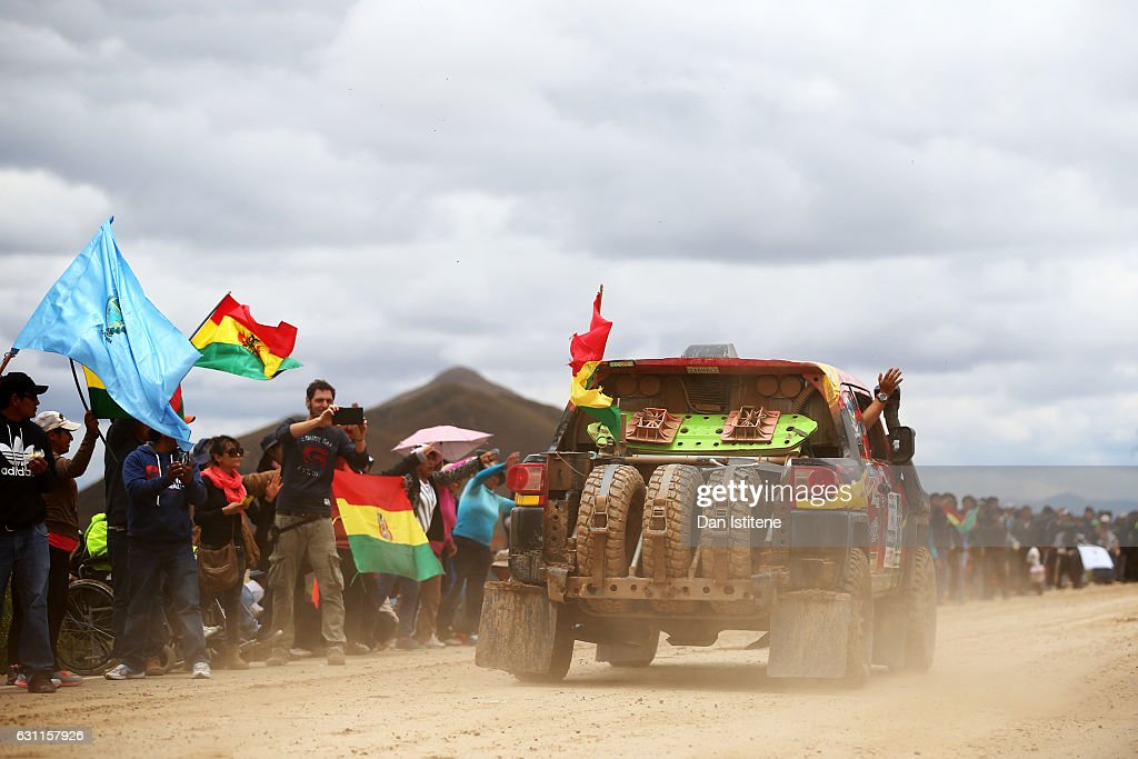 Fans cheer on Julio Cesar Roca Mercado of Bolivia and Toyota Propia and co-driver Hernan Daza Jimenez of Bolivia in their FJ Cruizer Toyota car as they depart the camp after stage six of the 2017 Dakar Rally between Oruro and La Paz was cancelled due to weather condtitons on January 7, 2017 in Oruro, Bolivia.