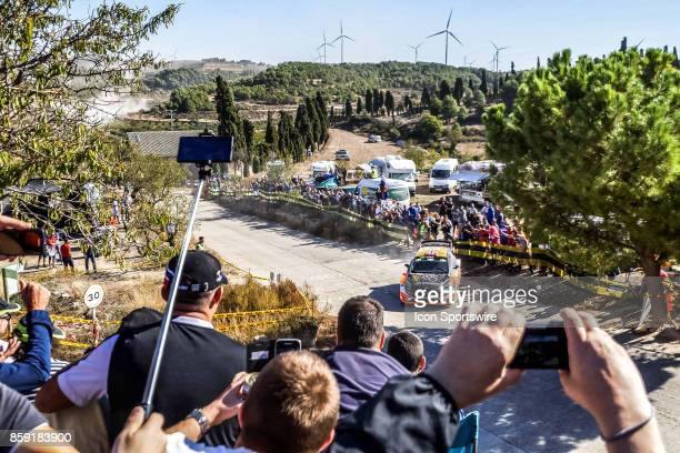 Fans cheer on Mads Ostberg and codriver Torstein Eriksen of MSport World Rally Team during the Terra Alta Stage of the Rally de Espana round of the...
