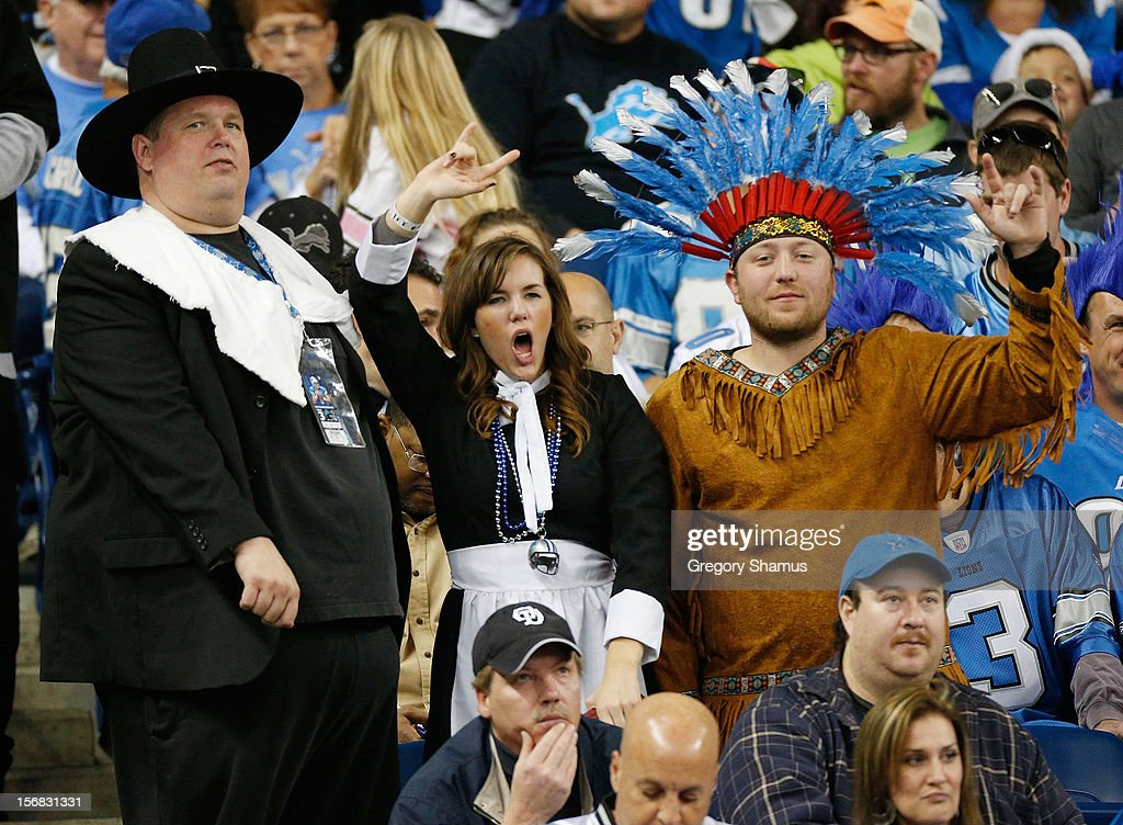 Fans cheer on Thanksgiving Day during the game between the Detroit Lions and the Houston Texans at Ford Field on November 22, 2012 in Detroit, Michigan.