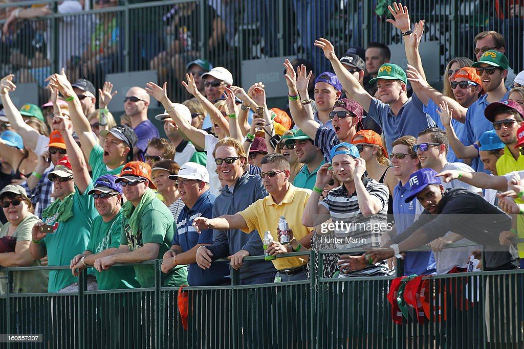 Fans cheer on the 16th hole during the third round of the Waste Management Phoenix Open at TPC Scottsdale on February 2, 2013 in Scottsdale, Arizona.