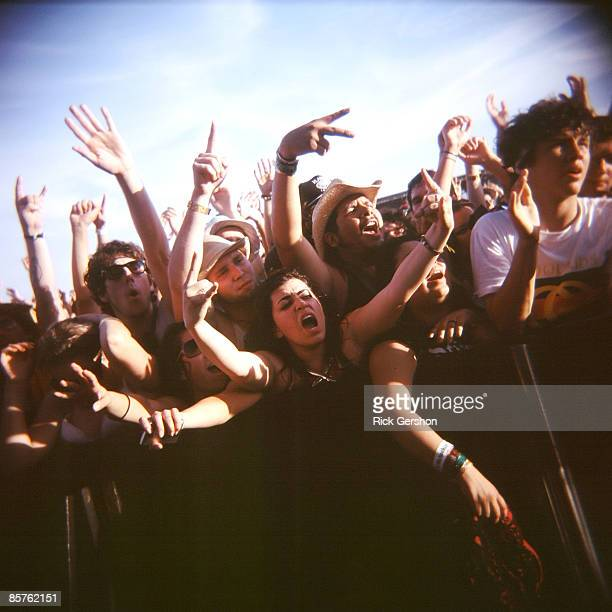 Fans cheer on the band Gogol Bordello at the Coachella Valley Music and Arts Festival at the Empire Polo Fields on April 27 2008 in Indio California...