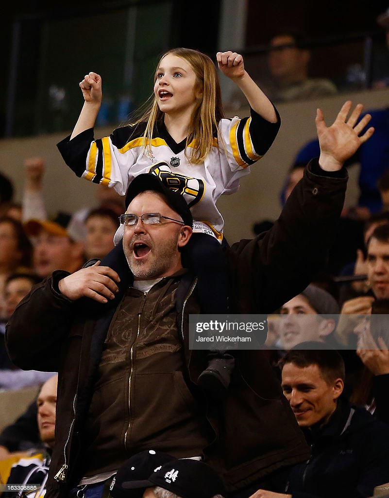 Fans cheer on the Boston Bruins during the game against the Toronto Maple Leafs on March 7, 2013 at TD Garden in Boston, Massachusetts.