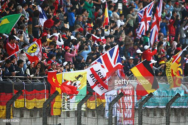 Fans cheer on the drivers during the Formula One Grand Prix of China at Shanghai International Circuit on April 12 2015 in Shanghai China