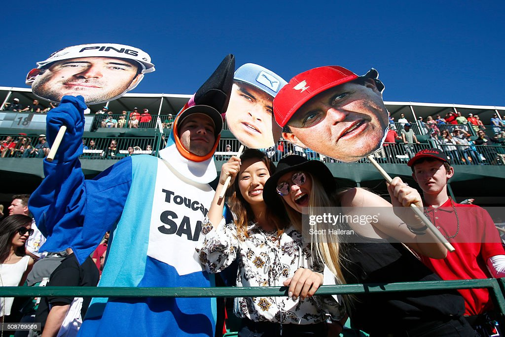 Fans cheer on the golfers on the 16th hole during the third round of the Waste Management Phoenix Open at TPC Scottsdale on February 6, 2016 in Scottsdale, Arizona.