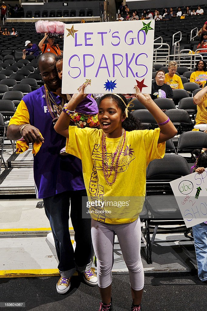 Fans cheer on the Los Angeles Sparks before playing against the Minnesota Lynx during Game Two of the WNBA Western Conference Finals at Staples Center on October 7, 2012 in Los Angeles, California.