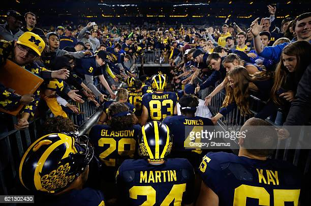 Fans cheer on the Michigan Wolverines as they leave the field after a 593 win over the Maryland Terrapins on November 5 2016 at Michigan Stadium in...