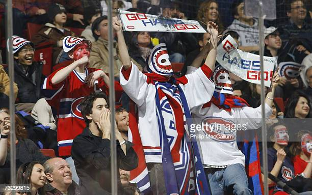 Fans cheer on the Montreal Canadiens during the NHL game against the Ottawa Senators on January 29 2007 at the Bell Centre in Montreal Quebec The...