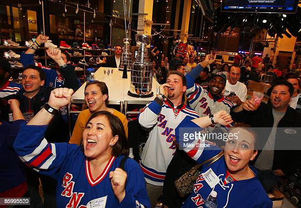 Fans cheer on the New York Rangers during the first round of the playoffs against the Washington Capitals during the NHL Playoff Kickoff Party on...