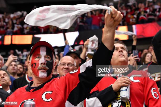 Fans cheer on the Ottawa Senators against the Pittsburgh Penguins in Game Six of the Eastern Conference Final during the 2017 NHL Stanley Cup...