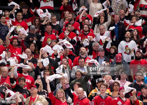 Fans cheer on the Ottawa Senators prior to a game against the Pittsburgh Penguins in Game Six of the Eastern Conference Final during the 2017 NHL...