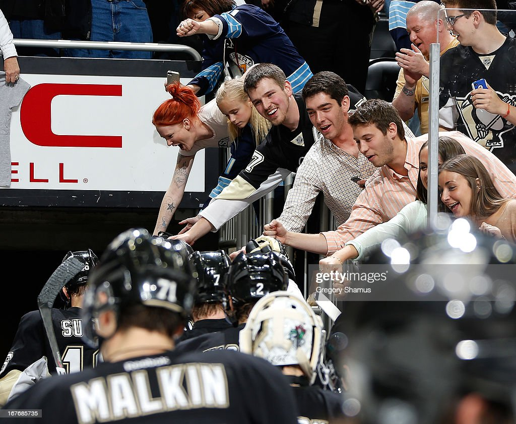 Fans cheer on the Pittsburgh Penguins as they leave the ice after a 8-3 win over the Carolina Hurricanes on April 27, 2013 at Consol Energy Center in Pittsburgh, Pennsylvania.
