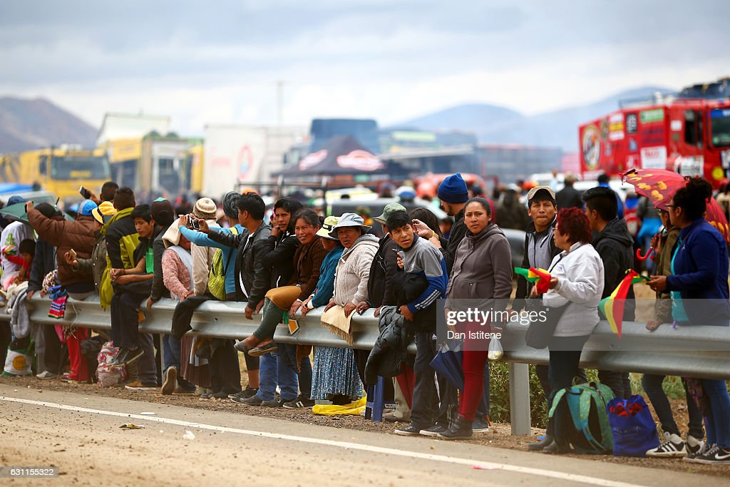 Fans cheer on the riders and drivers as they depart the camp after stage six of the 2017 Dakar Rally between Oruro and La Paz was cancelled due to weather condtitons on January 7, 2017 in Oruro, Bolivia.
