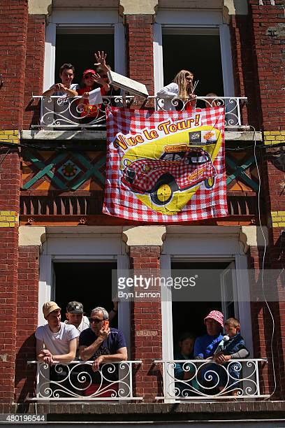 Fans cheer on the riders at the start of stage seven of the 2015 Tour de France a 1905km stage between Livarot and Fougeres on July 10 2015 in...