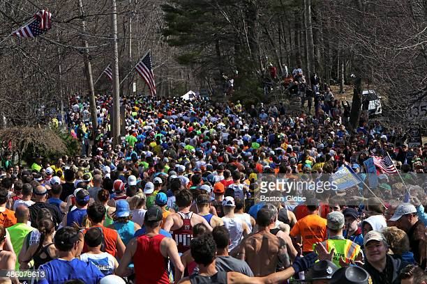 Fans cheer on the runners from along the road as they begin the 118th Boston Marathon on Monday April 21 2014