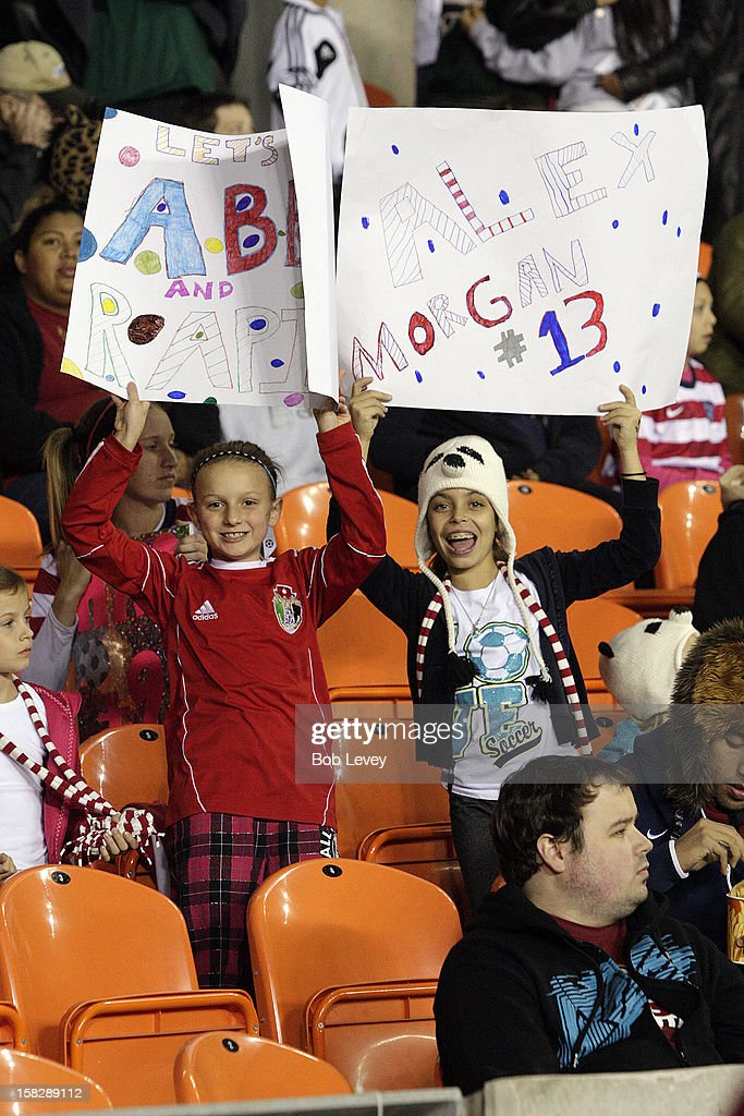 Fans cheer on the US Womens soccer team in the second half at BBVA Compass Stadium on December 12, 2012 in Houston, Texas. USA won 4-0.