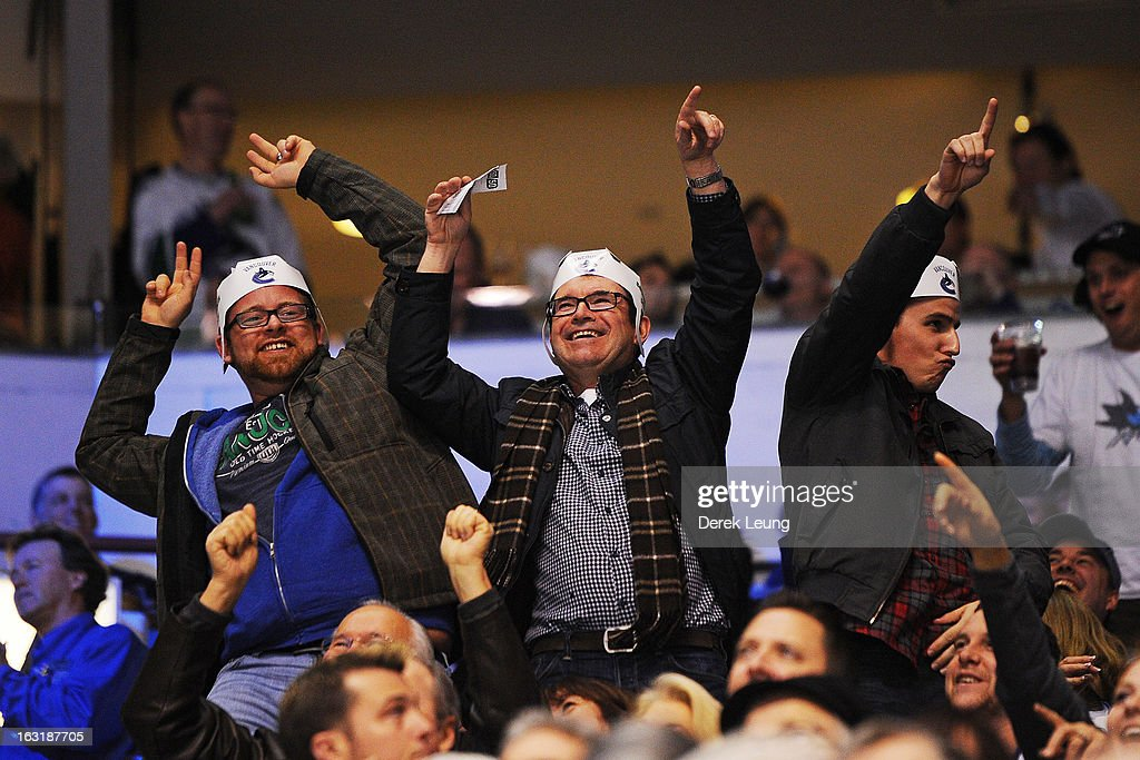 Fans cheer on the Vancouver Canucks during their game against the San Jose Sharks at Rogers Arena on March 5, 2013 in Vancouver, British Columbia, Canada.