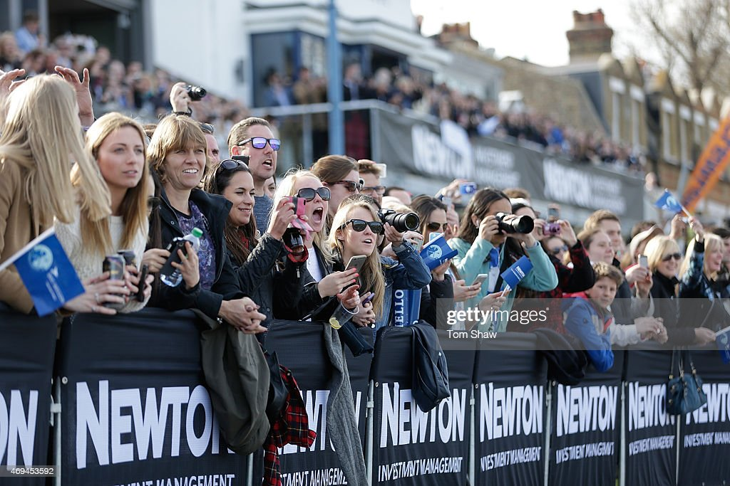 Fans cheer on the womens race during the Newton Investment Management Women's Boat Race between Oxford and Cambridge on April 11 2015 in London...