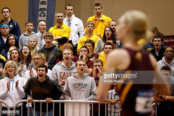 Fans cheer on their team at the Division III Men's and Women's Indoor Track and Field Championships held at the Al B Carius Track on the North...