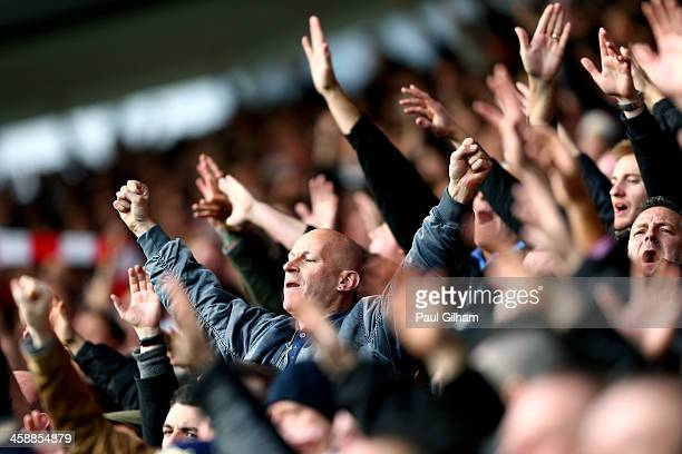 Fans cheer on their team during the Barclays Premier League match between Southampton and Tottenham Hotspur at St Mary's Stadium on December 22 2013...