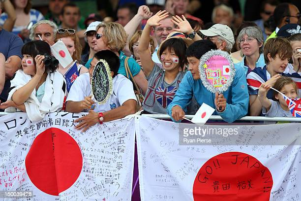 Fans cheer on Yumi Kida of Japan as she competes in the Women's Marathon 10km Swimming at Hyde Park on August 9 2012 in London England