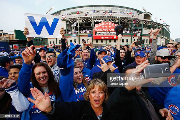 Fans cheer outside Wrigley Field before Game Three of the 2016 World Series between the Chicago Cubs and the Cleveland Indians at Wrigley Field on...